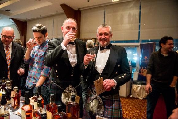 Whisky Live men in kilts drinking